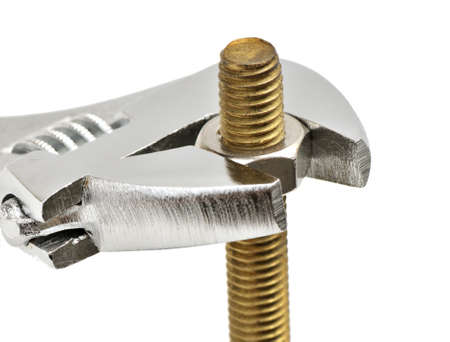 Bolt, nut and gaechy key on a white background. Stock Photo - 6909164