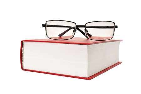 shortsightedness: book and glasses isolated on a white background                                     Stock Photo