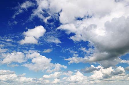 precipitation: white fluffy clouds in the blue sky