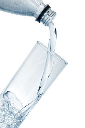 mineral water in glass isolated on a white                                    photo