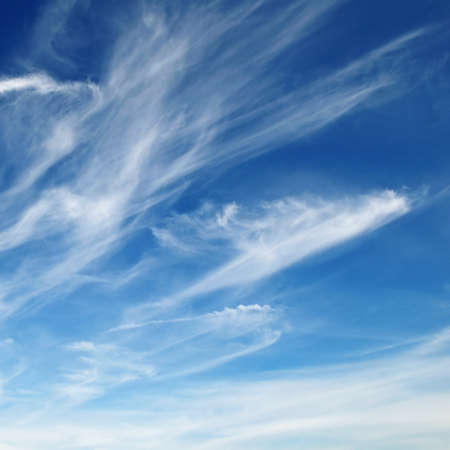 blue sky background: white fluffy clouds in the blue sky                                     Stock Photo