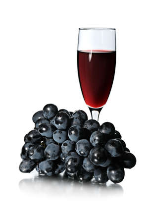 Glass of red wine and bunch of grapes isolated on white background. Stock Photo