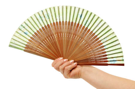 Fan in a woman hand isolated on white background                                     photo