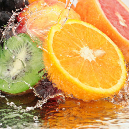fruit in a spray of water isolated on a white background. Stock Photo - 8228382
