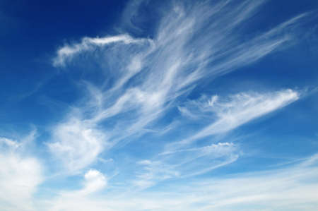 cloudscape: white fluffy clouds in the blue sky                                     Stock Photo