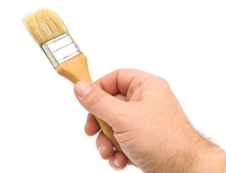 paint brush in hand isolated on a white                                     Stock Photo - 8638620