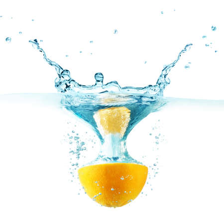objects: Orange falling into the water isolated on a white background.