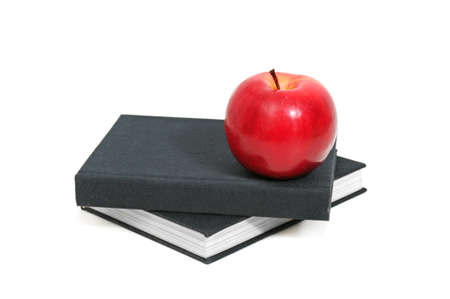 red apple on a book isolated on white background                                  photo