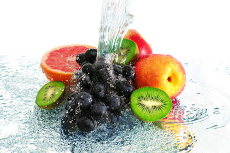 fruit in a spray of water isolated on a white background.                                     photo