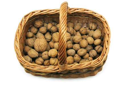 Wicker basket with nuts isolated on a white background                                      Stock Photo - 10477860