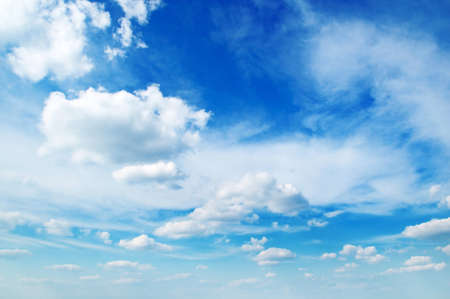 cumulus: white fluffy clouds in the blue sky                                     Stock Photo