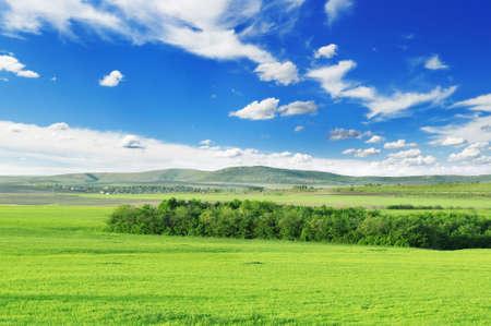 mountainous: Mountainous terrain and the blue sky.