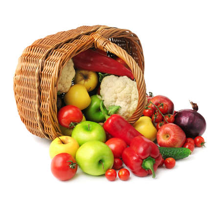fruit and vegetable in basket isolated on white background photo