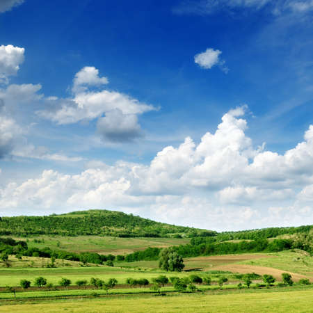distant: Mountainous terrain and the blue sky