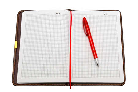 Notebook and pen isolated on a white background                                     photo