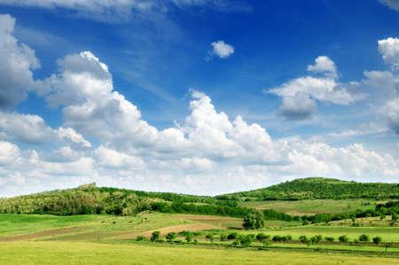mountainous: Mountainous terrain and the blue sky