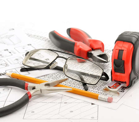 Tools and glasses on the drawing                                     photo