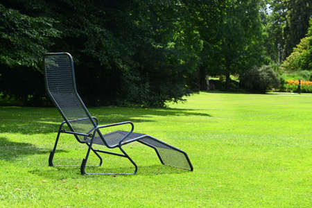 chaise longue: Chaise lounge on the green grass