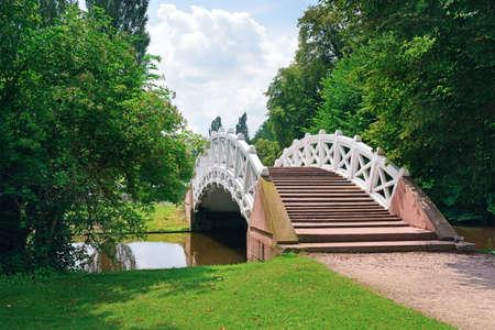 Stone bridge over the stream.                                     photo