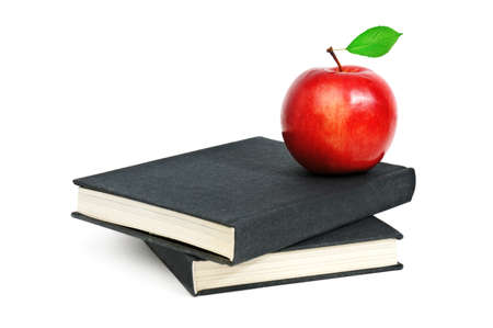 red apple on a book isolated on white Stock Photo - 16159441