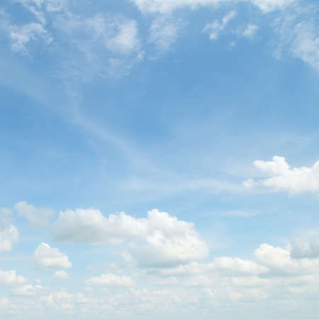 fluffy clouds in the blue sky                                     photo