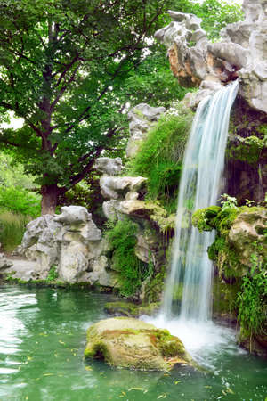 garden pond: Large waterfall in the park