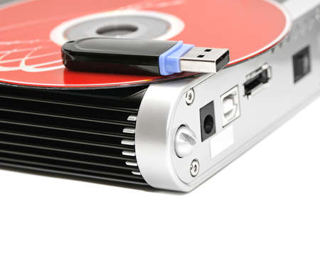 hard disk, flash memory and computer disk isolated on a white background photo