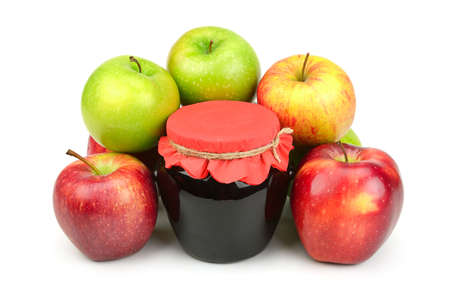 Red apples and pot of jam isolated on white background.