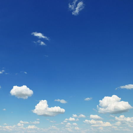 small white clouds on sky background Standard-Bild