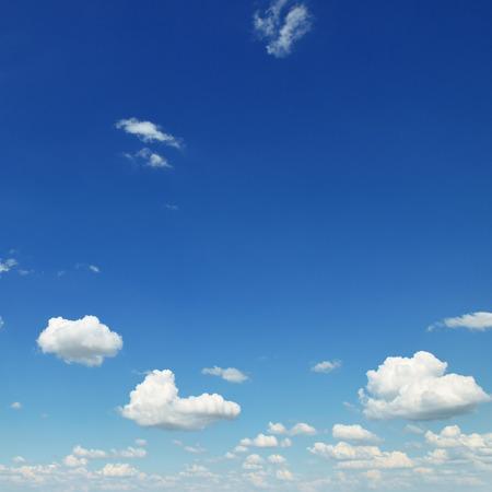 small white clouds on sky background Foto de archivo