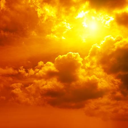 Beautiful bright sunset. Heavenly background. Standard-Bild