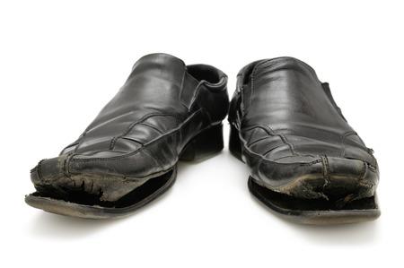 scarpa vecchia isolato su uno sfondo bianco