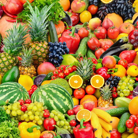 Assorted fresh ripe fruits and vegetables. Food concept background. Top view. Copy space.