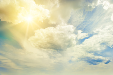 Bright sun on blue sky with beautiful white clouds.