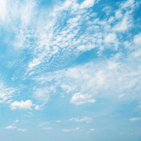 Light white clouds in blue sky. Copy space for text Zdjęcie Seryjne