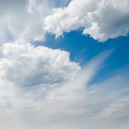 Beautiful cumulus clouds against  bright sky.