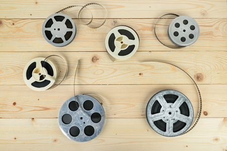 Reels with film on light wooden