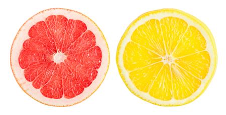 Two slices orange and grapefruit isolated on white Zdjęcie Seryjne