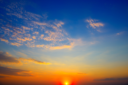 Scenic sunset on  bright blue sky and orange clouds