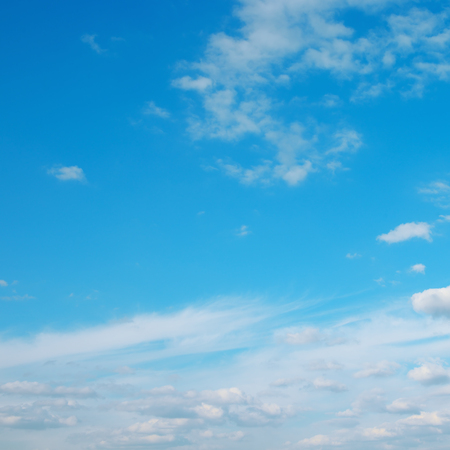 White cirrus clouds on beautiful blue sky.