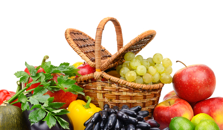 Healthy ripe fresh vegetables and fruits in basket isolated on white
