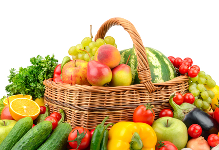 Large variety useful fruits and vegetables in willow basket isolated on white