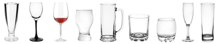 Assorted empty transparent glass products isolated on white