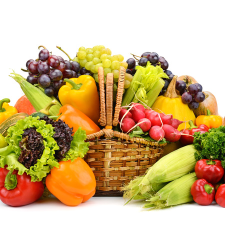 Healthy vegetables and fruits in willow basket isolated on white