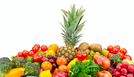 Set fruits and vegetables with pineapple in center isolated on white background.