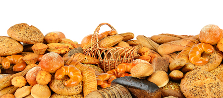 Big pile bread products isolated against white Zdjęcie Seryjne
