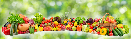Ripe juicy vegetables and fruits on natural green