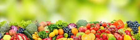 Fruits and vegetables on green blurred