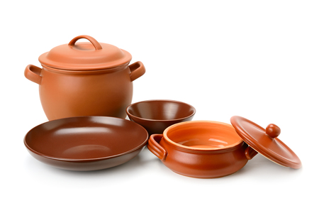 Clay pots, cup, bowls isolated on white Stock Photo