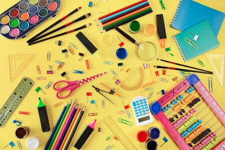 Set school supplies on yellow background. Flat lay. Top view Stock Photo